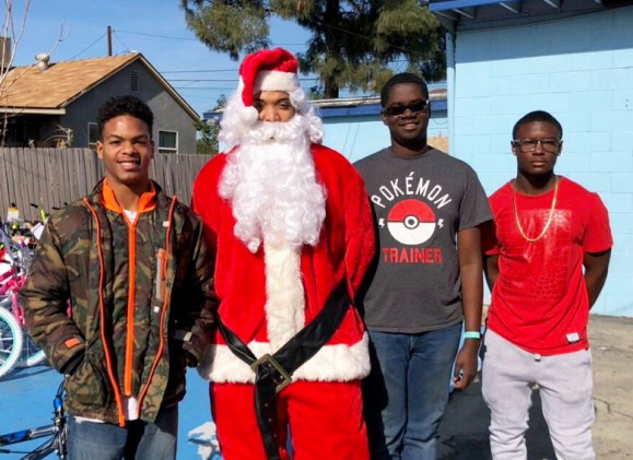 L/R: Zamir Subero Jordan Dean-Reynoso (Santa), Neuman Sneed and Marshon Smith (Not Featured: Syree Rucker-Spears, Tynan Currie, and Joseph Mills)