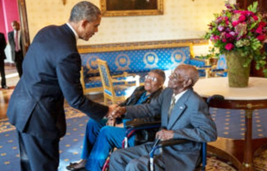 President Barack Obama greets Richard Overton, with Earlene Love-Karo, in the Blue Room of the White House, Nov. 11, 2013. Mr. Overton, 107, is the oldest living World War II veteran and was attending the Veteran's Day Breakfast at the White House. (Official White House Photo by Lawrence Jackson) This official White House photograph is being made available only for publication by news organizations and/or for personal use printing by the subject(s) of the photograph. The photograph may not be manipulated in any way and may not be used in commercial or political materials, advertisements, emails, products, promotions that in any way suggests approval or endorsement of the President, the First Family, or the White House. (Official White House Photo by Lawrence Jackson)