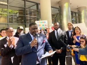 National Action Network, Sacramento President, Dr. Tecoy Porter speaks at a press conference before the Assembly Education hearing April 10, 2019 in front of Legislative Black Caucus Member Assemblymember Kevin McCarty who is authoring AB 1506.
