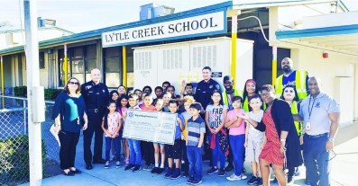 San Bernardino Police donated check to the Young Visionaries Youth Leadership Academy in the amount of $10,000.