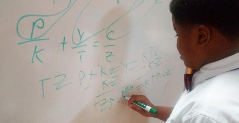 T.M Landry 5th grader D'Myrie Clay completes algebra problem for high school peers