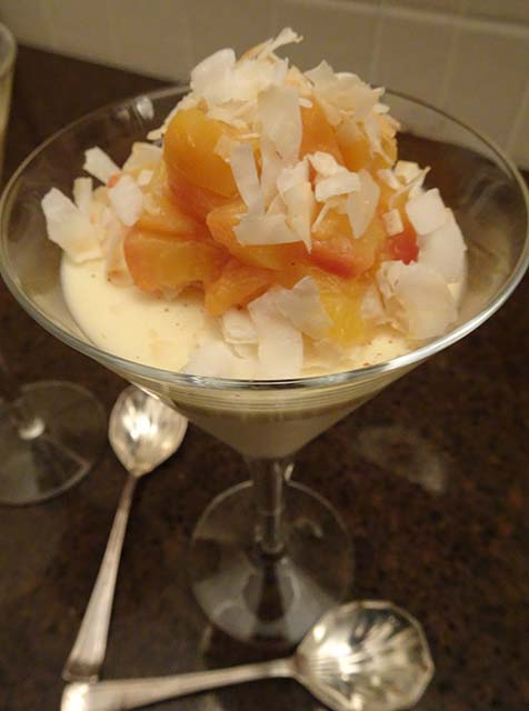 Spiced honey and yoghurt panna cotta topped with vanilla poached peaches and toasted coconut flakes