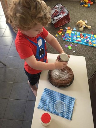 Putting Icing Snow on Nana's Chocolate Cream Cake-r