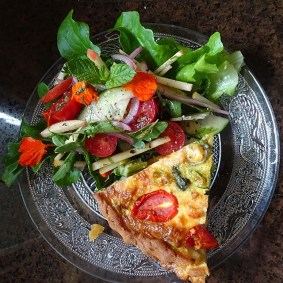 Fresh salad and edible flowers add colour and flavour to the plate.