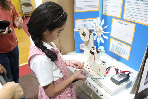 Can a Homemade Turbine Operated Manually Generate Power *Picture taken during the school wide science Fair