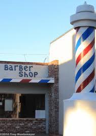 A barber pole outside of a barber shop in Rio Vista, California.