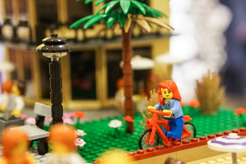 Lady riding bike in LEGO display at David Jones