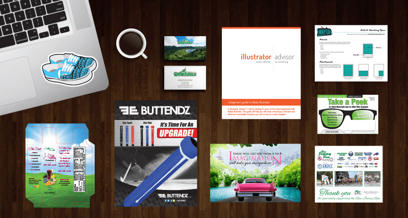 Various print marketing materials on a table.