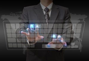 Businessman standing and working wth touch screen