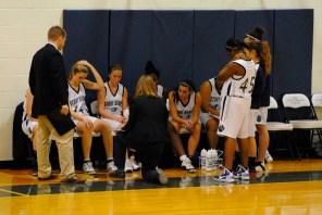 Coach Amy Helm talks to her squad