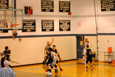 Tim Pandolfi drills a 3-pointer from the corner to start the game