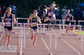 Hollis flies over a hurdle
