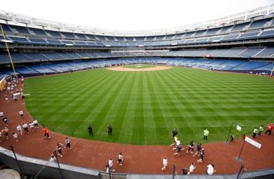 Runners round Yankee Stadium's warning track