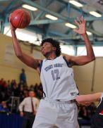 Jyles Etienne pulls down a rebound