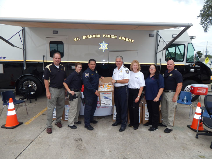 Sheriff James Pohlmann and Maj. Chad Clark hold up a box of drugs collected of prescription drugs turned in by the public at the drug take-back day in Chalmette on Sept. 26. Some 147 pounds, a record amount, in Chalmette, was collected to be destroyed. With them from left are Charles Mengel, store manager of the Walgreens in Chalmette where the event was held;  Cpl. Jessica Gernados, Capt. Pat Childress, Walgreens employee Cheryl Cage and Capt. Ronnie Martin.