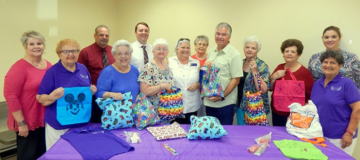 Members of the Chit Chats, a club in St. Bernard Parish, hold bags of items being donated to the Sheriff's Office for children being removed from negligent parents. From left are Judy Hoffmeister, Lynn Siegfried, Jackie Donnelly, Verleen Showalter, club President Shirley Pechon, Maxine Wilson, Sheriff James Pohlmann, Fay Shirley, Audrey Serigne and Betty Showalter In back row are Sheriff's Office Det. Capt. Mark Jackson. Det. Joe Warren and Det. Sgt. Michelle Canepa. Not pictured is Jamie Shultz, who also participated in making bags for children.