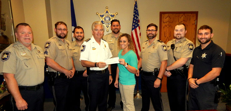 "Sheriff James Pohlmann presented a check for $2,350 to Jasmine Short of the American Cancer Society in New Orleans, on Nov. 30 and with them are seven deputies who were among 47 who pledged $50 each and took part in a ""Shaveless November'' to donate the money to the charity. The officers, from left, are Dep. Frank Auderer III, Sgt. Emile Breaux, Cpl. Jeff Babin, Sgt. Ryan Laylle, Capt. Justin Meyers, Dep. Robert Maloz and Dep. Richard Scheuermann."