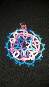 Even the back of the motif looks pretty! 5 Point Celtic Motif tatted by Natalie. Lizbeth thread size 40. Round 1 color Purple Iris Fushion (162). Round 2 & 3 colors Pink Blossoms (176) and Peacock Blues (149).