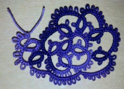 Snail designed by Nancy Tracy. Tatted by Natalie Rogers in Lizbeth thread size 20 and color Elderberry Jam (#177).