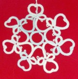 Sweetheart Snowflake pattern variation by Natalie Rogers. Original pattern is Gina Butler's garter. This snowflake variation is shared with permission from Gina.