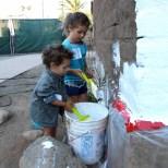 Special volunteers help whitewash the Presidio defense wall. Photo by Baron Erik Stafford.