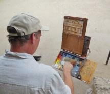 Thomas Van Stein begins his painting of the Casa. Photo by Anne Petersen.