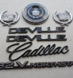 96 99 cadillac deville 32v northstar side fender decal wreath crown rear trunk logo [ 1024 x 768 Pixel ]