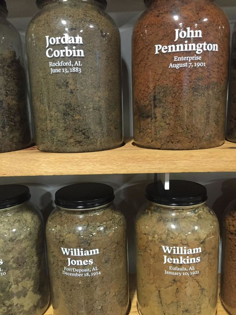 Jars holding dirt from the sites of lynchings. Photo by Christine Folch.