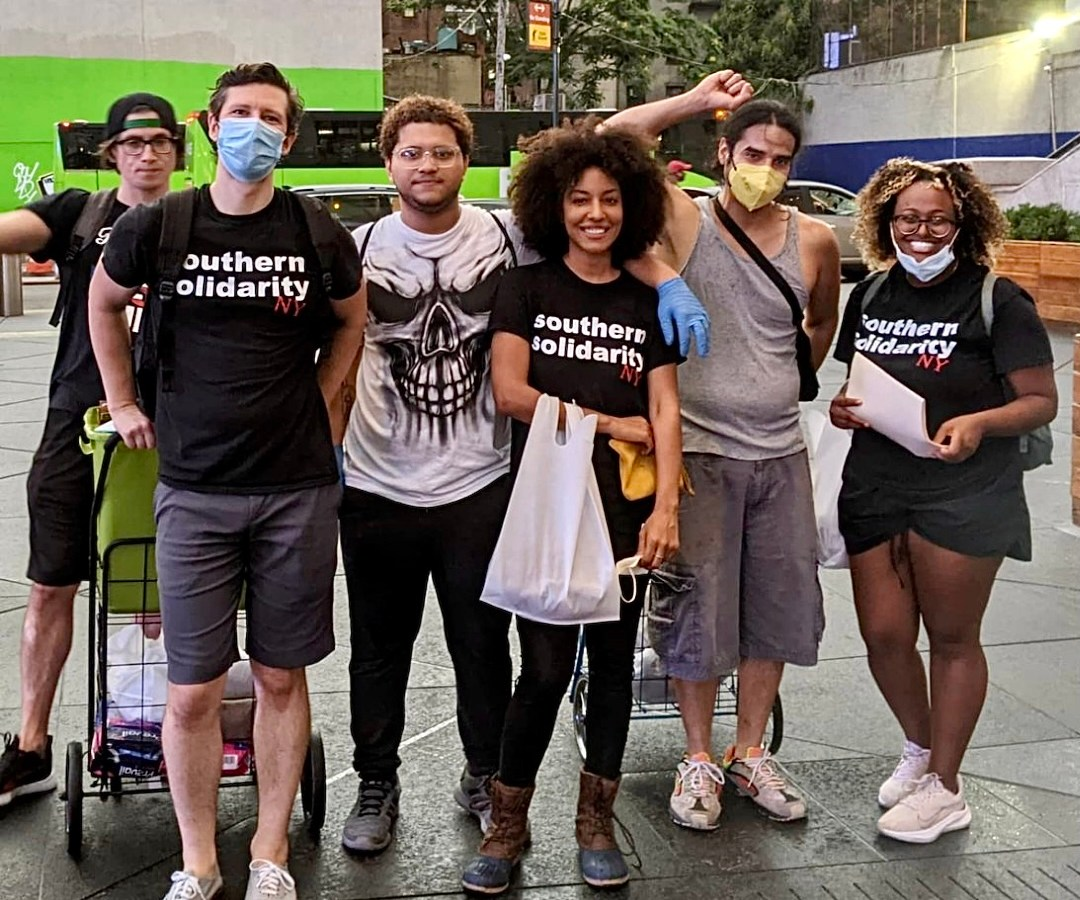 Volunteers with Southern Solidarity's New York team pause for a photo while handing out supplies to the city's unhoused folks.