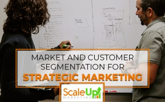 "blog title ""Market And Customer Segmentation For Strategic Marketing"" a header with a background of two men writing on a whiteboard"