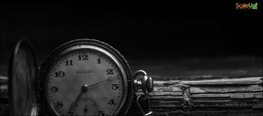 black and white image of an open pocket watch and a wooden stick behind it, this is an example of checking the number of years the crm industry