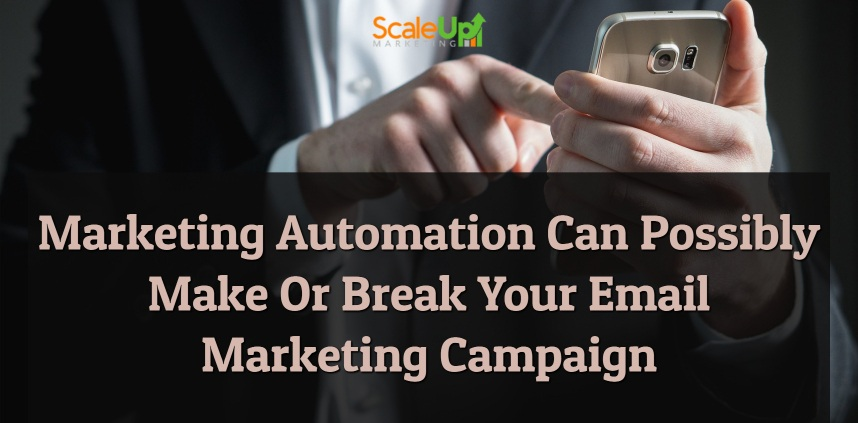 "header image of the blog title ""Marketing Automation Can Possibly Make Or Break Your Email Marketing Campaign"" with a person only half of it's body shown wearing corporate attire while holding a mobile phone on his left hand"