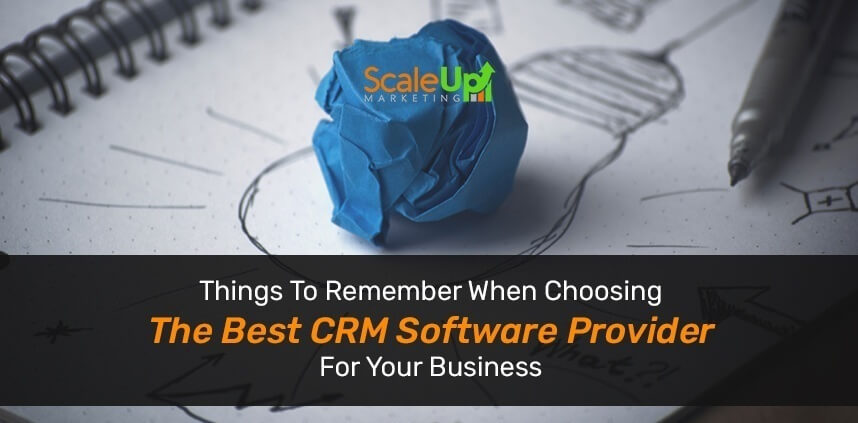"header image of the blog title ""Things To Remember When Choosing The Best CRM Software Provider For Your Business"" with a close-up shot of a blue crumpled paper above a light bulb drawing on a notebook"