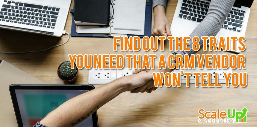 "header image of the blog title ""Find Out The 8 Traits You Need That A CRM Vendor Won't Tell You"" and an overhead shot of two agreeing and shaking hands with laptops on a wooden surface"