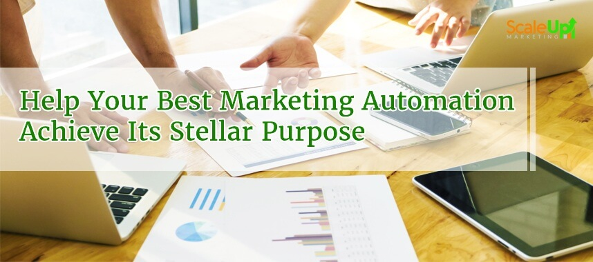 "header image of the blog title ""Help Your Best Marketing Automation Achieve Its Stellar Purpose"" with an over-the-head shot of two persons discussing on a wooden surface"