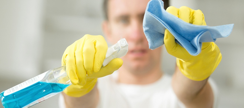 close-up shot of a man holding a cleaning equipment and wearing a colored yellow gloves indicating he is already using a product, this is one of the example of sales rejection