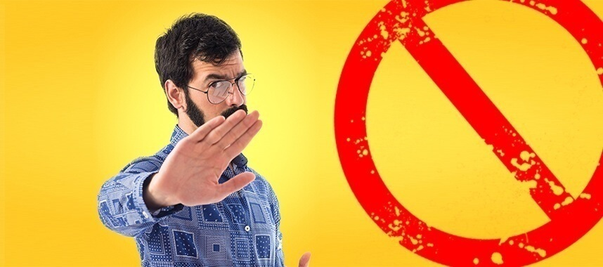 a guy on yellow background signals his right hand stop indicating his not interested, this is one of the example of sales rejections