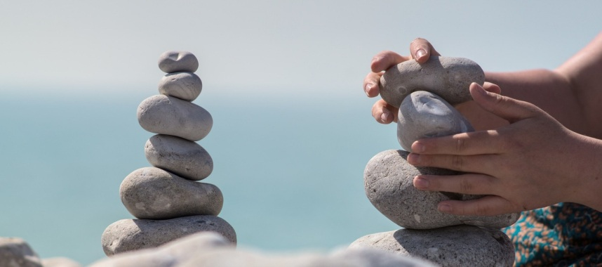 a piled stones and 2 hands balancing stones on the right side of the picture, this is one of the traits crm vendor want crm team to have