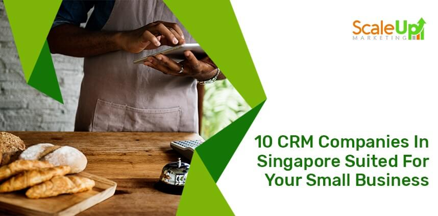 "header image of the blog title ""10 CRM Companies In Singapore Suited For Your Small Business"" with a background of a baker operating a tablet in front of a wooden table"
