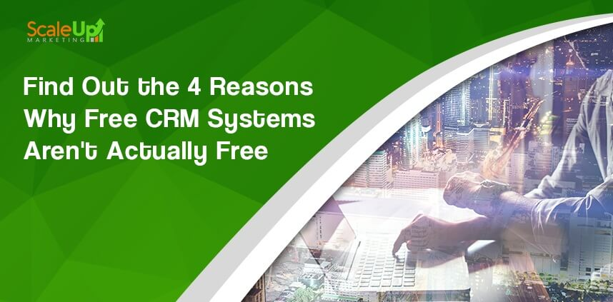 "header image of the blog title ""Find Out The 4 Reasons Why free crm Systems Aren't Actually Free"" and a sideview shot of a business man operating a laptop with a background of buildings"