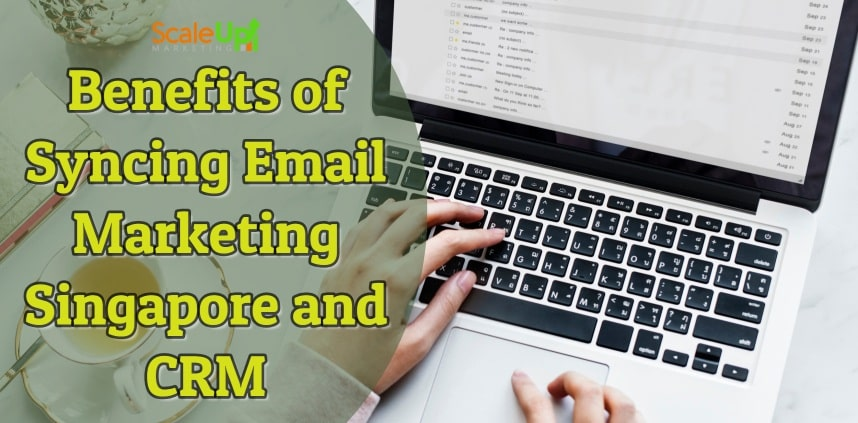"header image of the blog title ""Benefits of Syncing Email Marketing Singapore and CRM"" with a background image of a person's hand operating a laptop on a white surface"