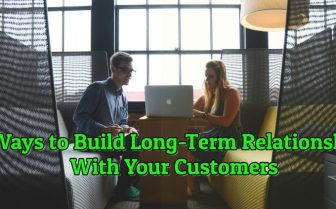 "blog title ""7 Ways to Build Long-Term Relationships With Your Customers "" with two person sitting on a bench talking to each other facing laptop"