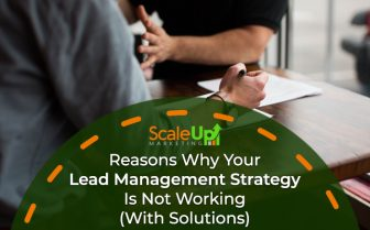 "Image Banner with a background image of two person having a meeting and a text ""Reasons Why Your Lead Management Strategy Is Not Working (With Solutions)"""