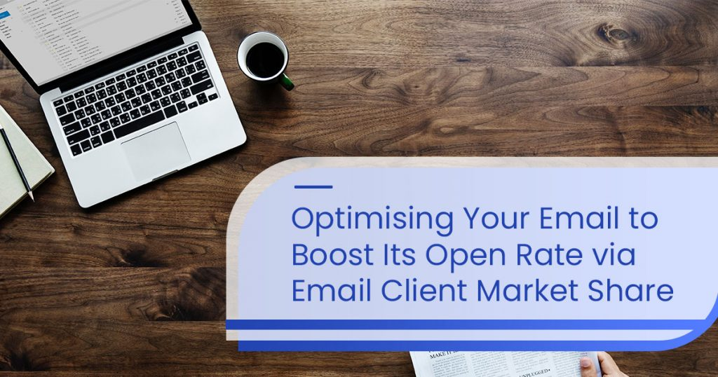 "banner image of a blog ""Optimising Your Email to Boost Its Open Rate via Email Client Market Share"" with a background of a laptop and a cup on a wooden table"