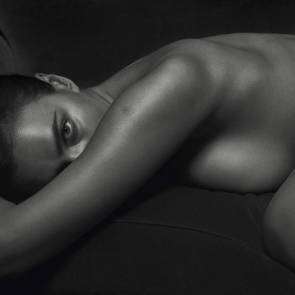 Irina Shayk naked sideboob pressed down the bed