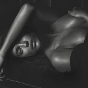 Irina Shayk nipple slip while lying