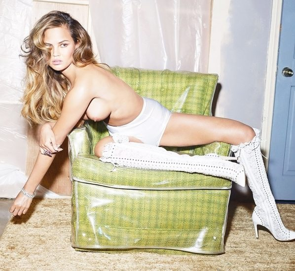 Chrissy Teigen nude boobs as sitting