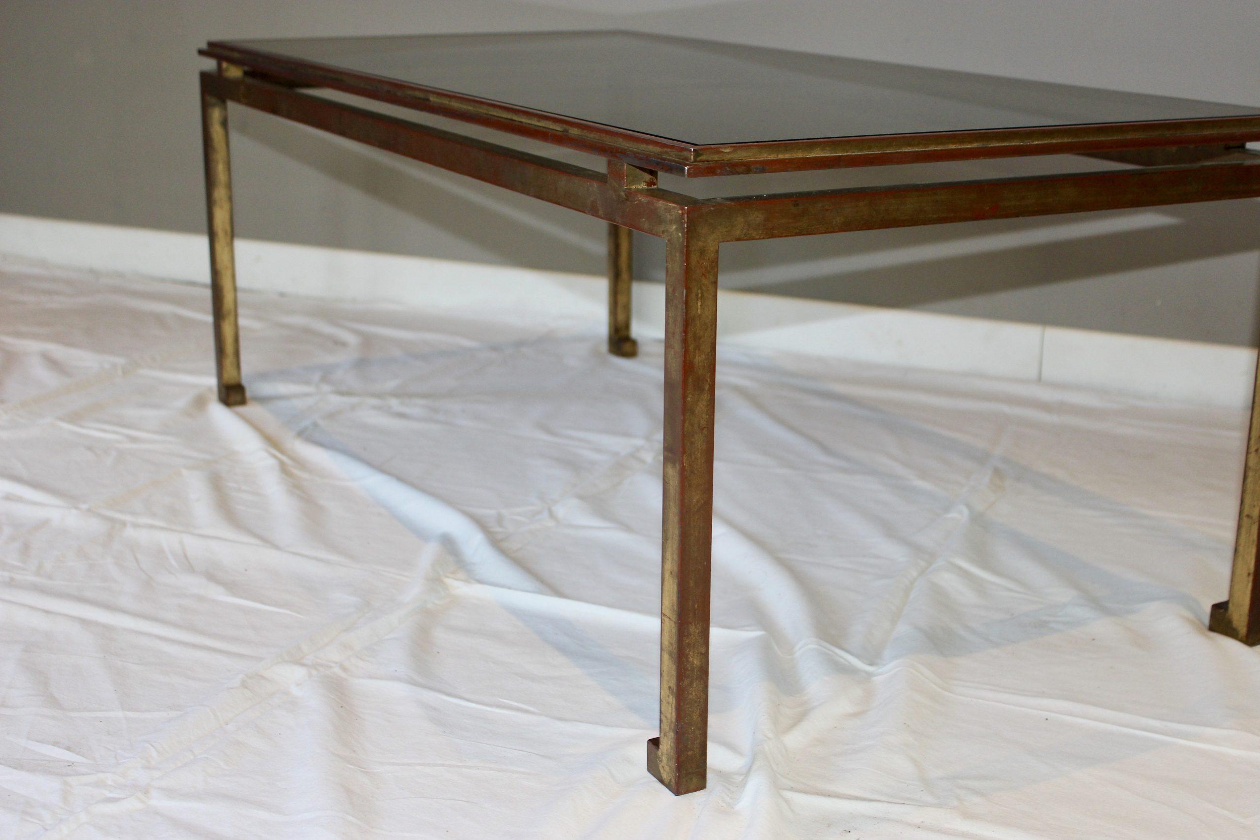 table basse vintage en verre et fer forge dore a la feuille par henri pouenat pour maison ramsay