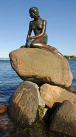 The Little Mermaid by Edvard Eriksen sits in Copenhagen harbour