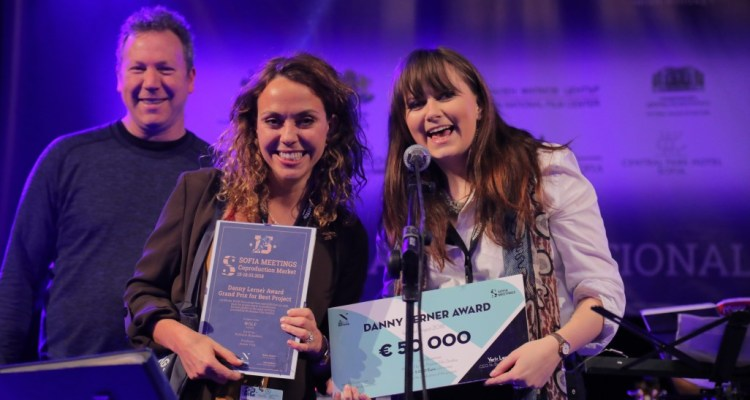 Nu Boyana Film Studios' CEO Yariv Lerner, Nathalie Biancheri, and Producer Jessie Fisk with the award for Wolf